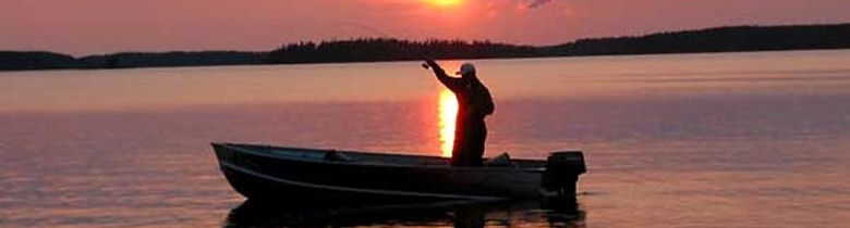 2 People in Canoe Fishing at Sunset