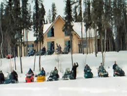Snowmobiles Lined Up in Front of the Lodge