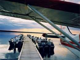 Boats & Plane Tied to Dock